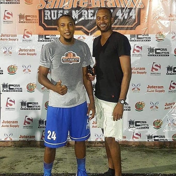 Jeffrey Harris, left, coordinator of the Sangre Grande Ruff & Ready 4v4 Basketball League, shares a moment with veteran player Steven