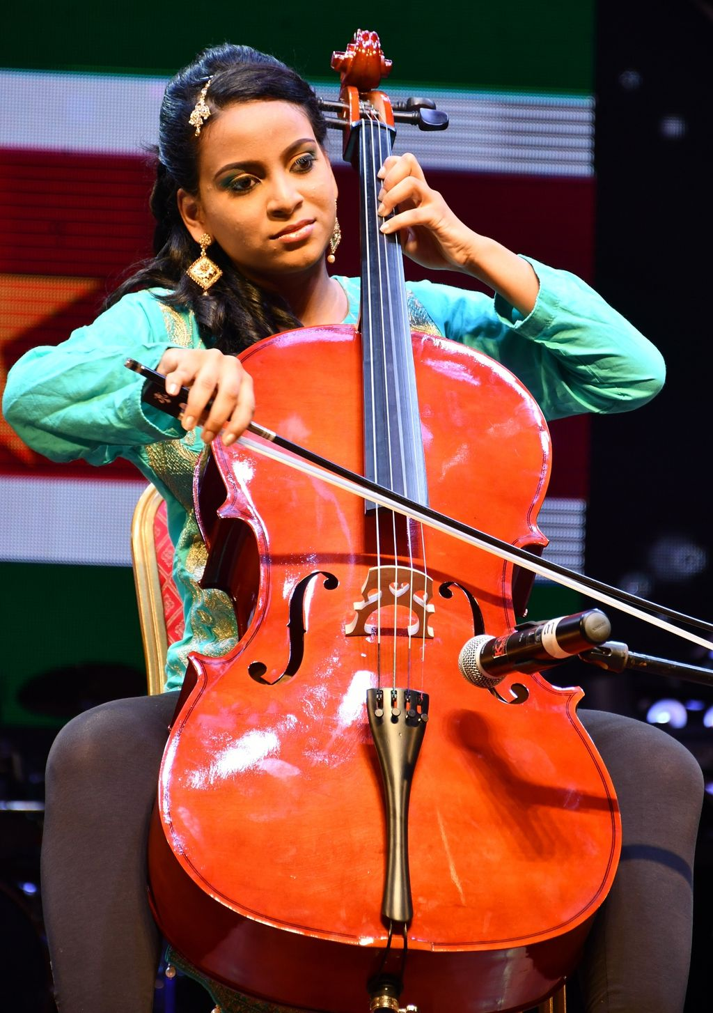 Robin Nandlal of Suriname plays the cello during the talent section of the pageant.