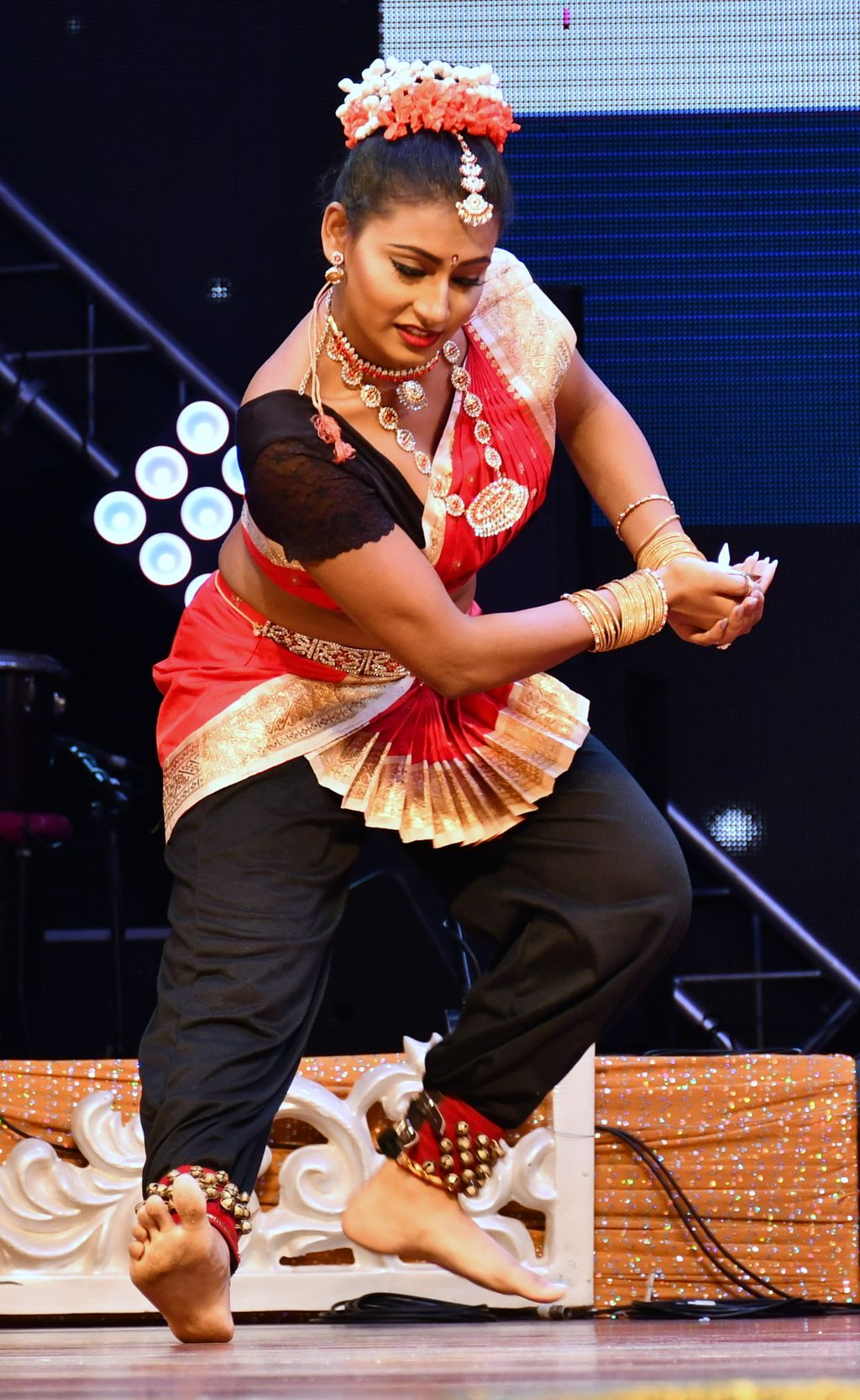 2018 Queen and winner of the talent competition Preejanjali Ria perform a dance during the talent section of the pageant.