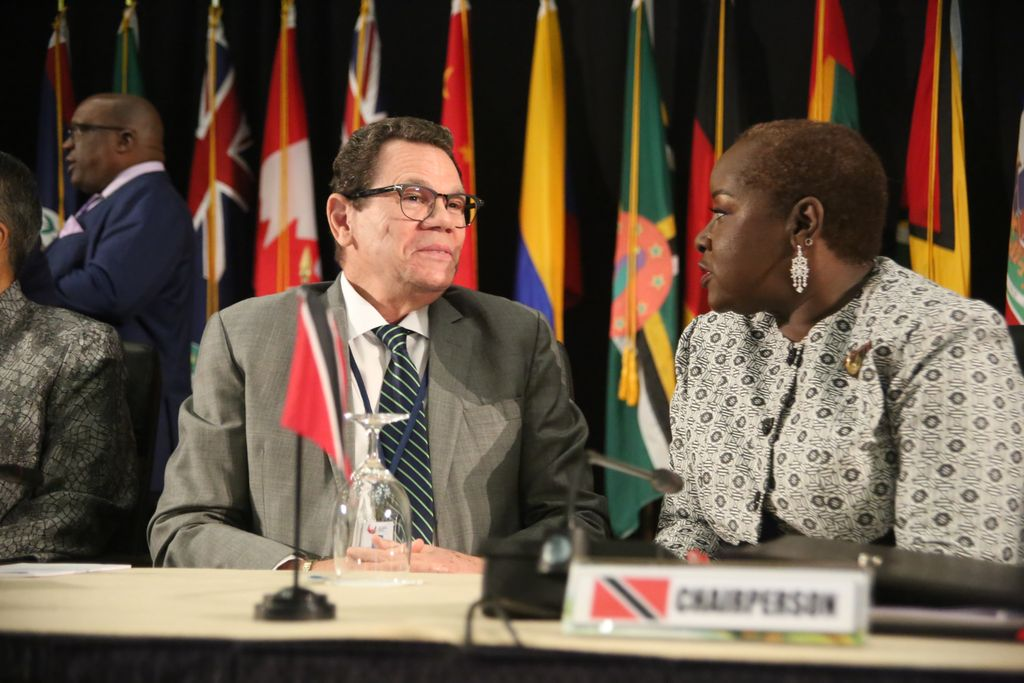 Caribbean Development Bank Board of Governors chairwoman Camille Robinson-Regis, right and Caribbean Development Bank president Warren Smith chat during the 49th Annual Meeting of the Board of Governors at the Hyatt Regency, Port-of-Spain, yesterday.
