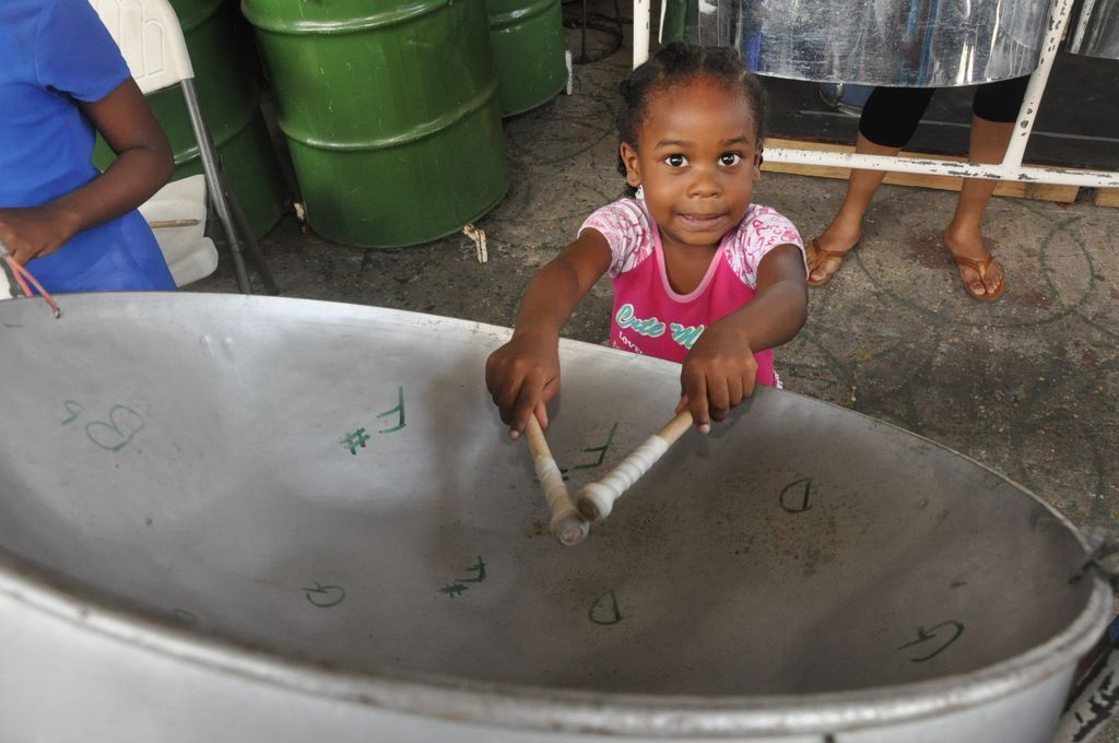 Four year old Ascala Daniels plays a the tenor pan at the Steel Foundation's eight annual Summer Pan Camp at the Pan Palais along the Southern Main Road, Marabella yesterday.