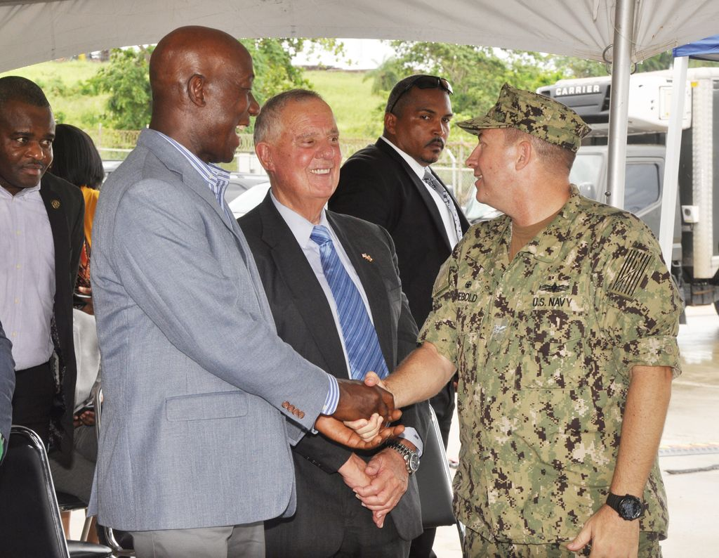 Prime Minister Dr Keith Rowley speaks with Captain Brian J Diebold, right, and Ambassador Joseph Mondello during the closing ceremony of the USNS Comfort in Trinidad at Gate A, Port of Brighton in La Brea, yesterday.