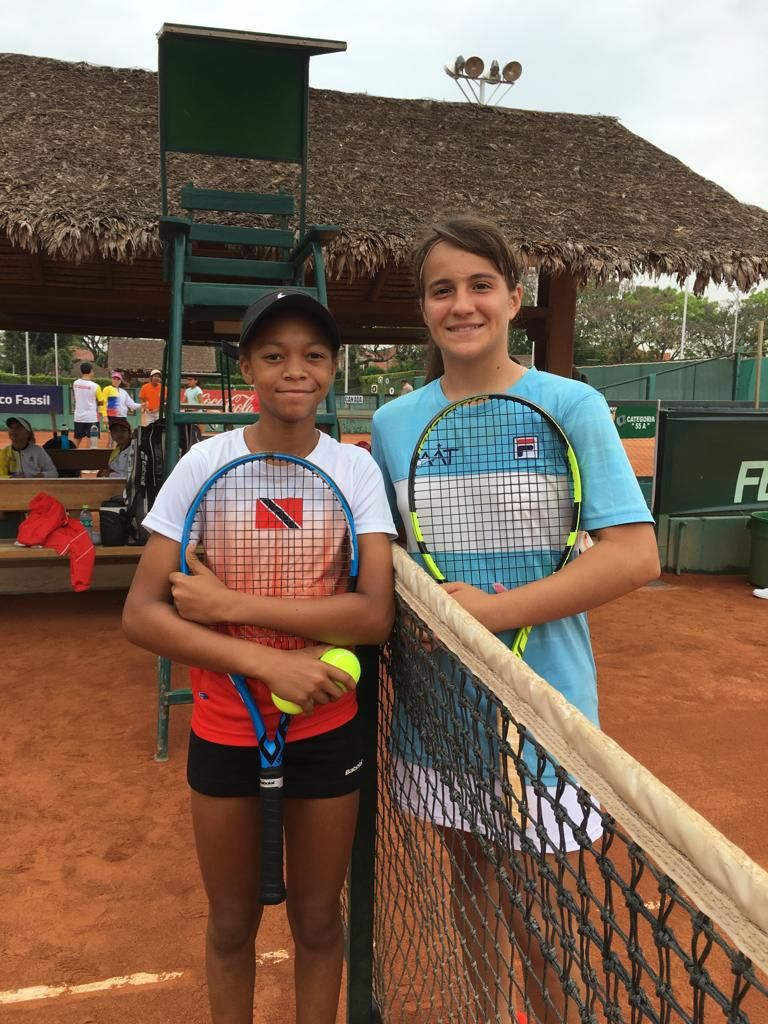 T&T tennis ace Jaeda-Lee Daniel-Joseph and her opponent Carolina Enria after her encounter yesterday.