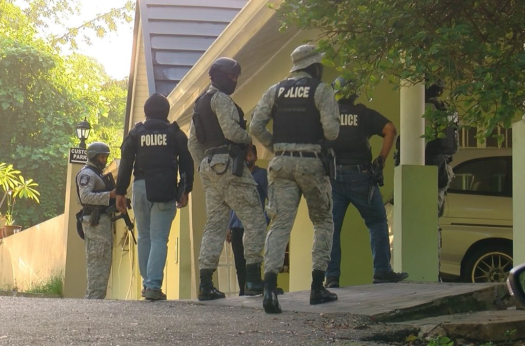 Officers of the Special Operations Response Team (SORT) during the raid of a house on Chancellor Heights yesterday morning.