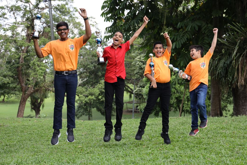 From left, Teevan Samlal, Ivan Maharaj, Bruce Boodoo and Kristoff Seebaran celebrate after placing in the top three at the UCMAS International competition in Cambodia on December 8.